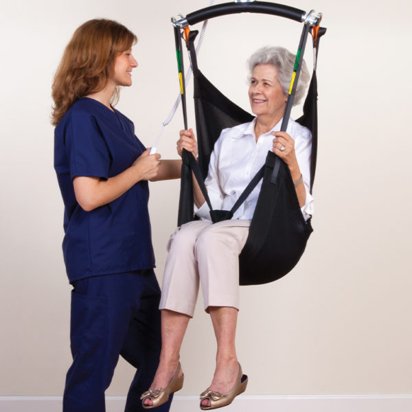 comfort care sling in use with nurse handicare 600x600