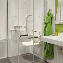 ergonomic shower seat white in use handicare