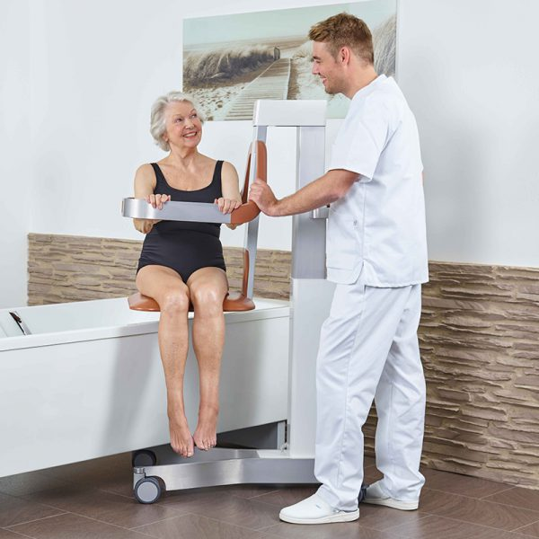 beka eve bath and shower lift patient with caregiver