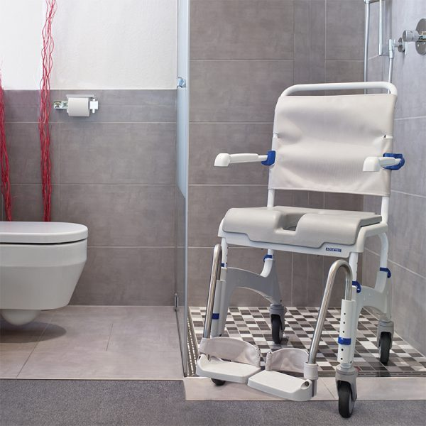 invacare aquatec ocean commode in bathroom