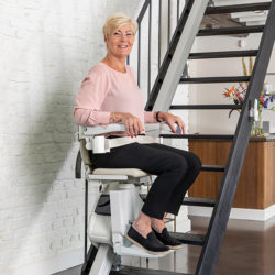1100 straight stairlift woman in use